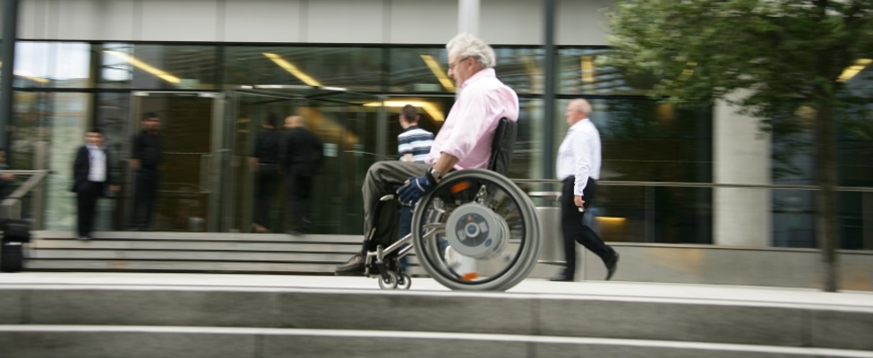 Mail wheelchair user outside building