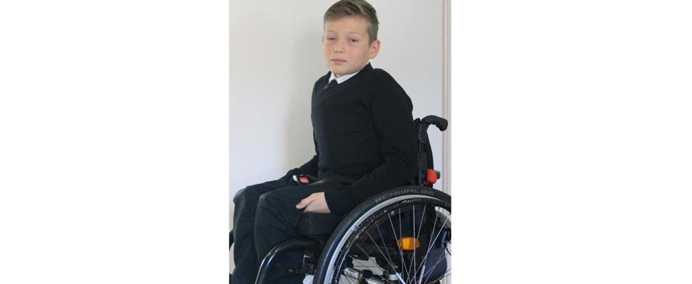 Callum in his wheelchair