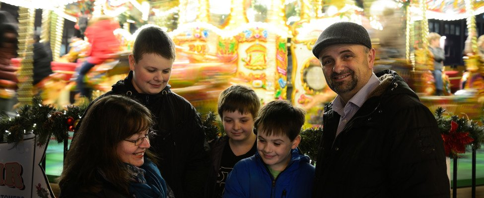 Nick and Chole with sons at funfair