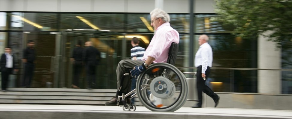 Man in suit in wheelchair