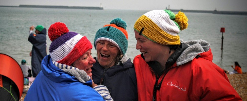 relay channel swimmers in wolly hats