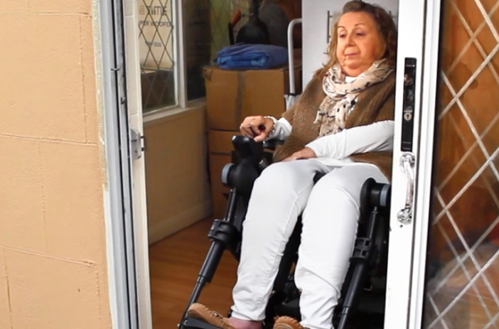 Tracey in wheelchair trying to leave her house