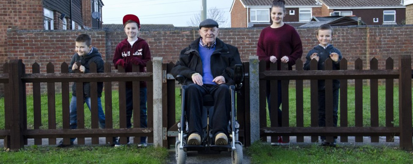 Richard in his wheelchair flanked by 4 of his grandchildren