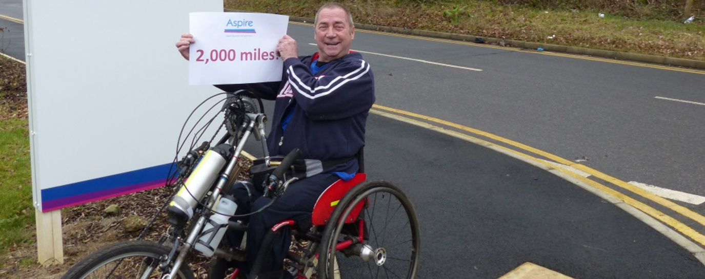 Joe Gilbert with 2000 miles sign